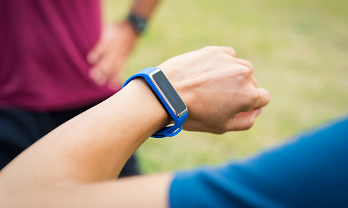 Man's wrist with fitness tracking device